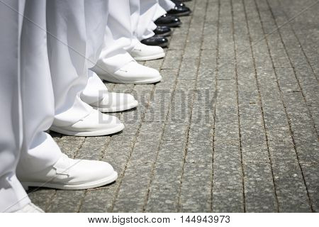 NEW YORK MAY 27 2016: Close up of white dress shoes worn by US Navy personnel during the re-enlistment and promotion ceremony at the National September 11 Memorial site during Fleet Week 2016.
