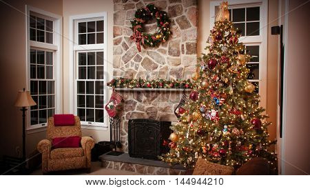 Christmas decorated house: a Christmas tree a brown chair and a fireplace
