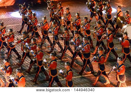 MOSCOW RUSSIA - AUGUST 26 2016: Spasskaya Tower international military music festival. The Mongolia Honor Guard and the Central Military Band of the Armed Forces from Mongolia at the Red Square