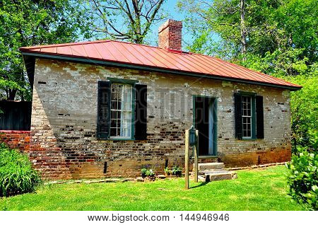 Hillsborough North Carolina - April 20 2016: Two room brick schoolhouse at the 1821 Burwell School for Women Historic Site *