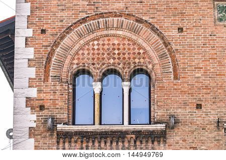 Triple lancet window of Italian medieval palace.