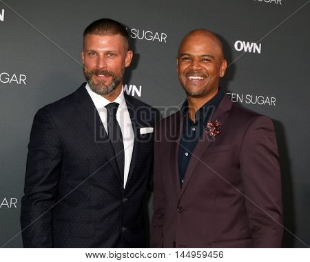 LOS ANGELES - AUG 29:  Greg Vaughan, Dondre T. Whitfield at the Premiere Of OWN's