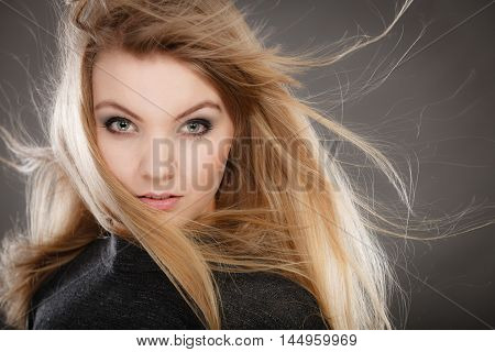 Gorgeous Blonde Woman With Open Waving Hair.
