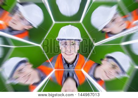 Portrait of a male worker reflected in the mirrows