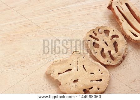 Lotus Root With Dry Out On Wooden Table