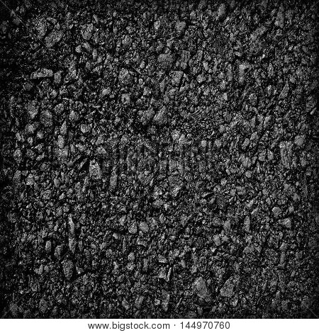 Background texture of rough asphalt; Black texture background; The texture of asphalt; Pavement; dark grey asphalt pavement texture with small rocks