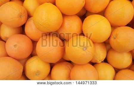 Fresh oranges background. Many fruit - fresh raw orange.