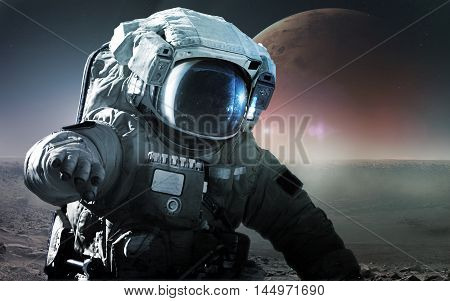 Astronaut walking on an unexplored planet. Elements furnished by NASA