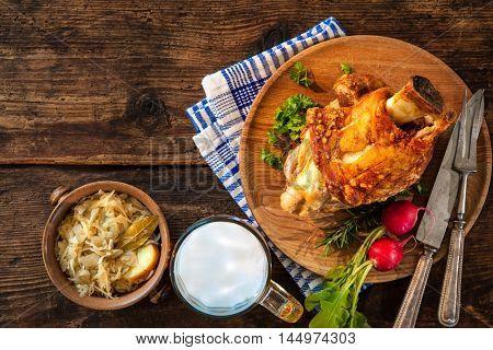 Pork knuckle with beer and sauerkraut. Oktoberfest