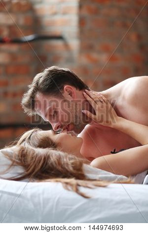 Relationship. Lovely couple in bed