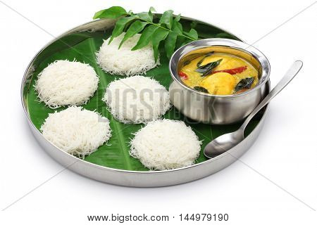 idiyappam (string hoppers)  with egg curry, south indian and sri lankan cuisine isolated on white background