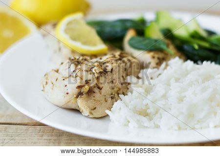 Chicken breasts with thyme lemon rice and spinach salad. Healthy and diet eating concept