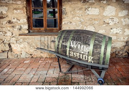 Adelaide Australia - August 13 2016: Old barrel with wine tasting text installed near cafe frontyard on main street of Hahndorf German Village