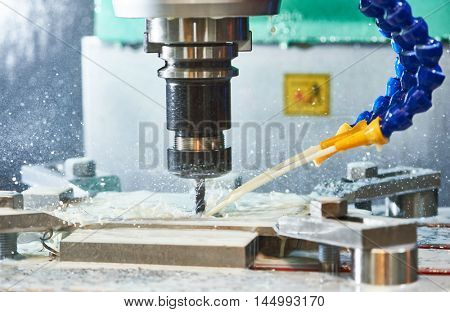 Milling metalworking process. Industrial CNC metal machining by vertical mill