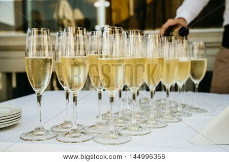 glasses with luxury champagne on the table