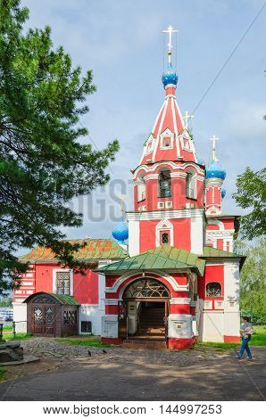 UGLICH RUSSIA - JULY 19 2016: Unknown woman goes near Church of Tsarevich Dmitry on Blood Uglich Russia