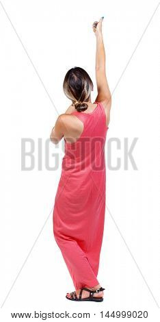 back view of standing girl pulling a rope from the top or cling to something. A slender woman in a long red dress shows thumb up raising his arm above his head.