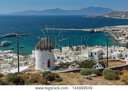 Amazing Seascape of white windmill and island of Mykonos, Cyclades, Greece