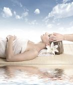 Attractive woman getting spa treatment isolated on white poster