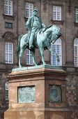 The equestrian statue of King Frederik VII in front of the Christiansborg Palace in Copenhagen Denmark poster