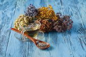 Aromatic lavender tea and wild chamomile on table poster