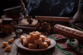 Turkish Still life, Arabic traditional dessert rahat lukum, lokum powdered with sugar, eastern candy. Seasonal and holidays ramadan, seker bayram concept. Smoky hookah atmospheric. poster