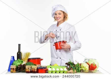 Preparing Dishes. Young Female Cook Preparing Food At Table. Professional Cook In White Suit. Woman