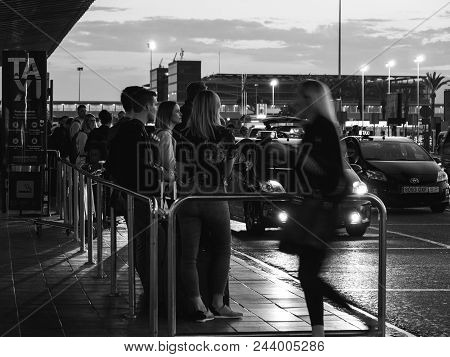 Barcelona, Spain - May 31, 2018: Tourists And Visitors Of Barcelona Waiting For The Taxi Car In Queu