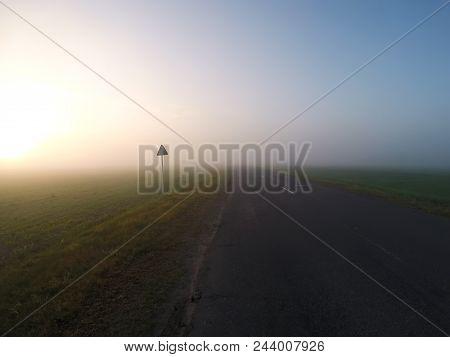 Foggy Road At Dawn, Thick Fog, Dawn Over The Field