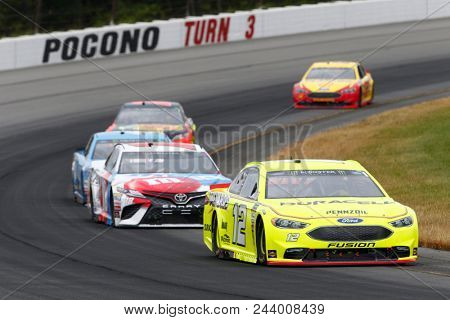 June 03, 2018 - Long Pond, Pennsylvania, USA: Ryan Blaney (12) battles for position during the Pocono 400 at Pocono Raceway in Long Pond, Pennsylvania.