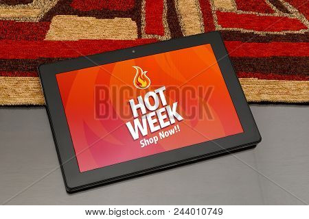 Tablet Over The Table With Hot Week Advertising On The Screen. Marketing, E-commerce, Publicity.