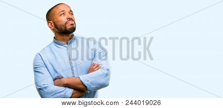 African american man with beard doubt expression, confuse and wonder concept, uncertain future isolated over blue background