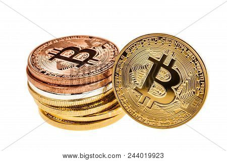 Studio Shot Of A Bitcoin Physical Golden Coin Leaning Over A Stack Of Euro Coins. Bitcoin Is A Block