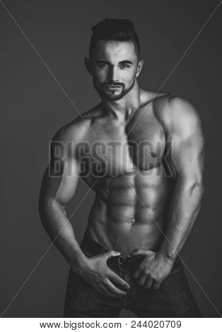 Sexy Gay. Sport And Workout. Athletic Bodybuilder Man On Grey Background. Man With Muscular Body And