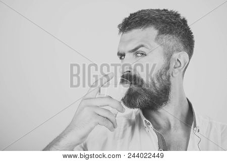 healthy food. Health and dieting. Hangover and thirst. Life source and healthcare. Man with long beard hold water glass on yellow background. Hipster drink clean healthy water, refreshing, copy space poster