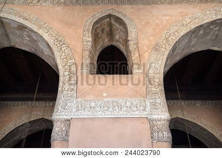 Arched Window Between Two Arches Decorated With Floral Patterns At Ibn Tulun Historical Mosque, Old