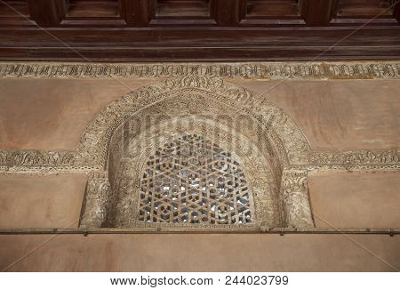 Perforated Arched Stucco Window Decorated With Geometrical Patterns And Calligraphy At Ibn Tulun Mos