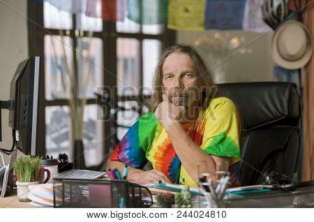 Man In Tie Dye Shirt At His Desk