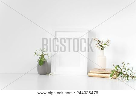 White Frame Mock Up With Spring Cherry Bouquet. Mockup For Your Photo, Design Or Text.