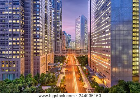 Shinjuku, Tokyo, Japan cityscape throught the Metropolitan Goverment Buildings at dusk.