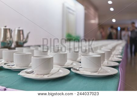 Empty Cups Of Coffee In A Row At Conference Hotel