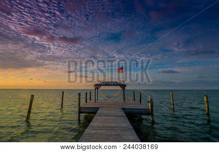 Limelight: Sunrise Over The Atlantic Ocean At A Boating/fishing Dock/pier In Islamorada, Florida Key