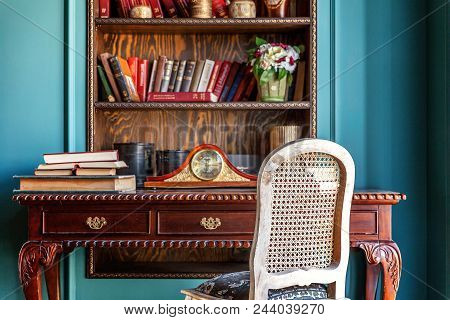 Luxury Classic Interior Of Home Library. Sitting Room With Bookshelf, Books, Table And Chair. Clean