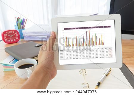 Business Concept Of Office Working, Hand Holding Tablet