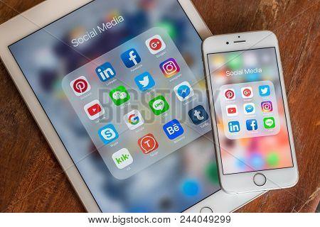 Bangkok, Thailand- August 14, 2018: Social Media App Icons On Ipad, Iphone Touchscreen Mobile Cross-