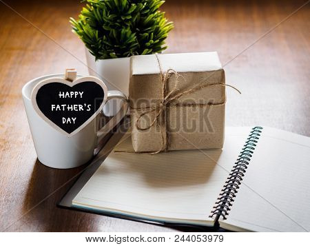 Happy Fathers Day Concept. Coffee Cup With Gift Box, Heart Tag With Happy Father's Day Text, Noteboo