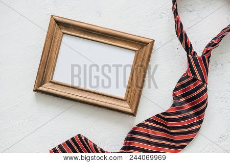 Flatlay, Necktie And Blank Frame. Father's Day Concept