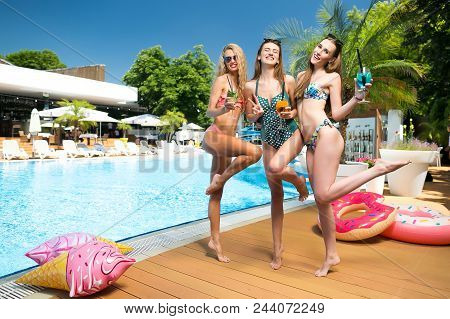 Alcohol, Merriment, Party Concept. By The Summer Outdoor Swimming Pool That Is Placed By The Bar Wit