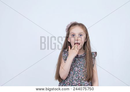 Portrait Of Adorable Surprised Astonished Little Girl Isolated On A White. Girl Child Holding Hands