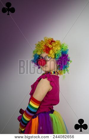 Little Girl In Clown Costume And The Theme Of The Cards -peaks. Little Girl With Glasses And Red Nos